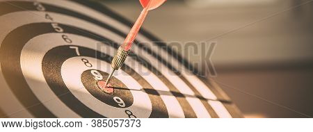 Bulls Eye Or Dart Board Has Red Dart Arrow Throw Hitting The Center Of A Shooting Target For Busines