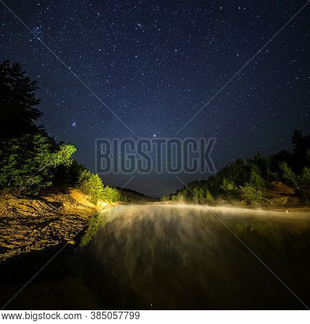Small Lake Under Stars At Night With Foggy Vapour At Summer