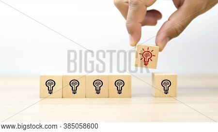 Close Up Hand Choosing A Light Bulb Icon On Cube Wooden Toy Blocks Concepts Of Idea Human Resources