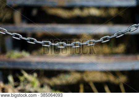 A Metal Chain Blocking A Trespass, Outdoor Closeup