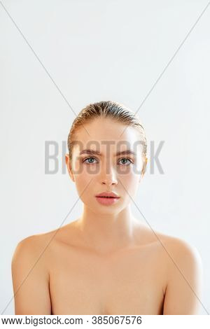 Skincare Cosmetology. Face Rejuvenation. Portrait Of Sensual Woman With Nude Makeup Bare Shoulders L
