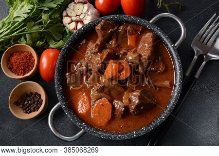 Beef Bourguignon In A Pan. Stew With Red Wine ,carrots, Onions, Garlic, A Bouquet Garni, And Garnish