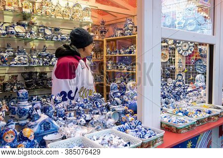 Moscow, Russia - December 18, 2019: Colorful Porcelain Utensils And Souvenirs In Gzhel Style At Chri