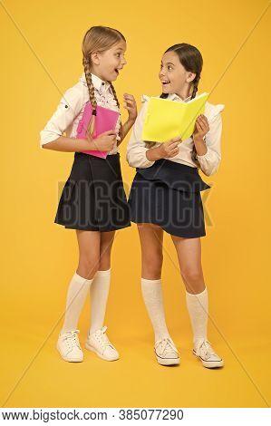 Book Club. Cheerful Classmates With Workbook. Little Girls In School Uniform. Back To School. Readin