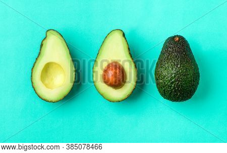 Top View Of  Avocado Isolated On Green Background. Ripe Fresh Green Avocado