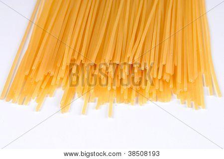 raw spaghetti on a white dish soft shadows