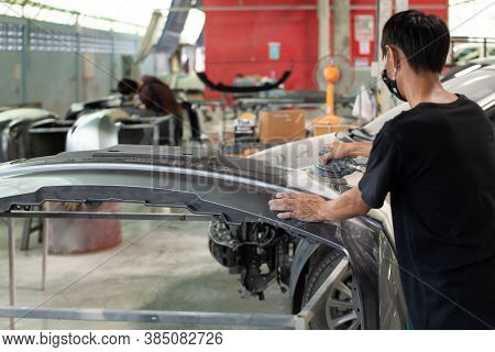Checking Car Body Work Fiber Bumper At Car Garage
