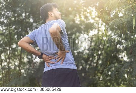 Young Asian Runner Sustains A Back Pain Injury, Sport Injury, Man With Back Pain
