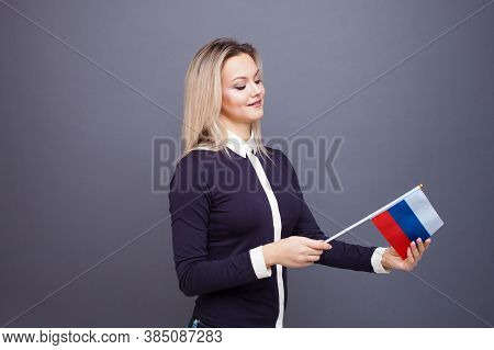 Immigration And The Study Of Foreign Languages, Concept. A Young Smiling Woman With A Russia Flag In