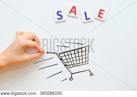 Female Hand With The Trade Cart On Sale