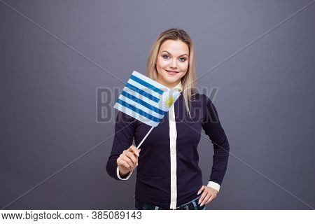 Immigration And The Study Of Foreign Languages, Concept. A Young Smiling Woman With A Uruguay Flag I
