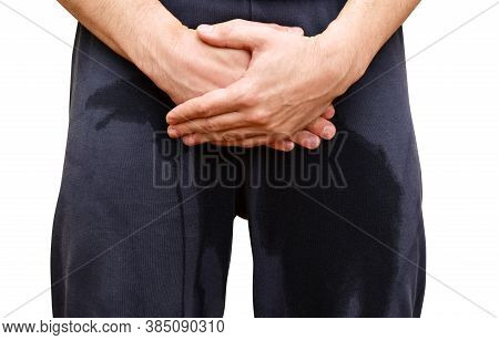 Urinary Incontinence And Continence Problems. A Man Standing In Wet Pants. Human Body Problem Or Hea