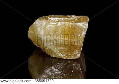 Macro Mineral Stone Yellow Calcite On A Black Background