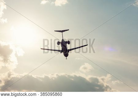 Private Jet Plane Landing In A Backlight