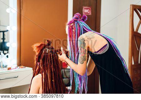 Beautiful Woman Barber Braids Dreadlocks With Tattoo Making Trendy Braids Dreadlocks In The Her Barb