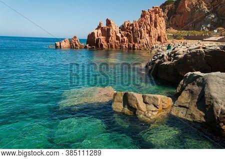 Sardinia Coastline: Typical Red Rocks And Cliffs Near Sea In Arbatax; Italy