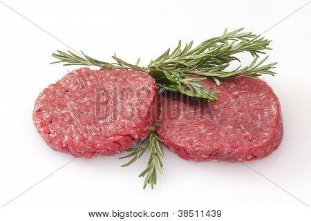 Raw Hamburgers Isolated On White Background