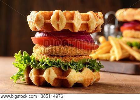 Closeup Chicken Waffle Sandwich With Lettuce And Tomato
