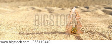 Timber Christmas Tree With Star Sits In Pristine White Sand With Idyllic Beach Background. A Summer