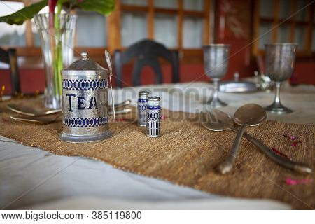 Antique Tea Set With Cutlery And Cups On The Table