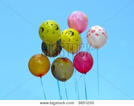 Bunch Of Colored Party Balloons Against Blue Sky