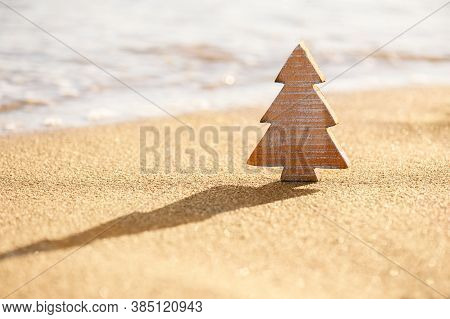 Timber Wooden Christmas Tree On A Sand On The Tropical Beach Near Ocean, Summer Christmas And Winter