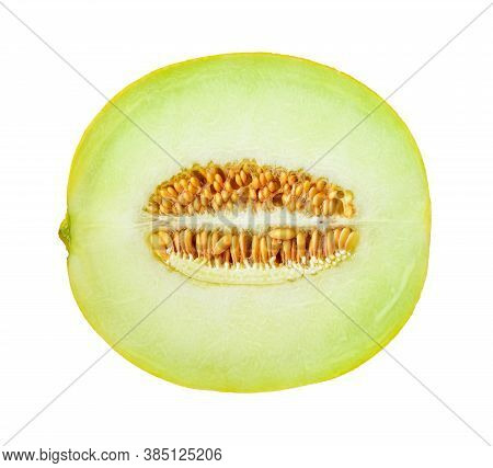 Half Of Ripe Melon With Seeds Isolated On White Background. Sweet Green Pulp Of Juicy Galia Melon. I