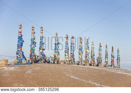 Columns With Colorful Ribbons On Cape Burhan. The Sacred Place Of Shamanism. Lake Baikal Landscape