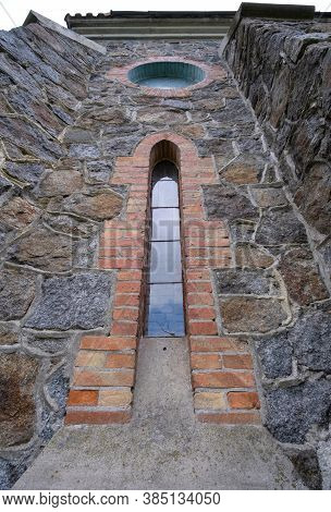 Old Window With Stained Glass On Facade Of The Building. Baroque And Gothic Architecture. Neo-gothic