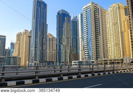 Dubai/uae - November 7, 2019: View Of Jbr Street With Colorful Skyscrapers On A Blue Clear Sky Backg