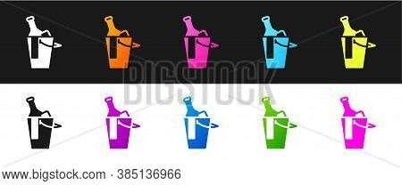 Set Bottle Of Wine In An Ice Bucket Icon Isolated On Black And White Background. Vector