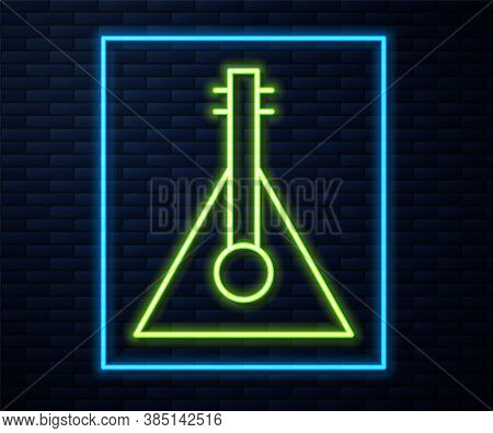 Glowing Neon Line Musical Instrument Balalaika Icon Isolated On Brick Wall Background. Vector