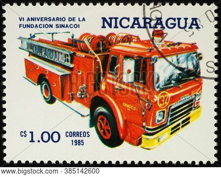 Moscow, Russia - September 13, 2020: Stamp Printed In Nicaragua Shows Red Firetruck, Circa 1985