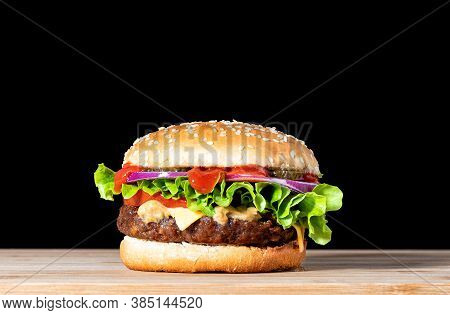 Delicious Cheeseburger With Beef Cutlet, Lettuce, Tomato Slices, Red Onion And Sesame Seed Bun. Chee