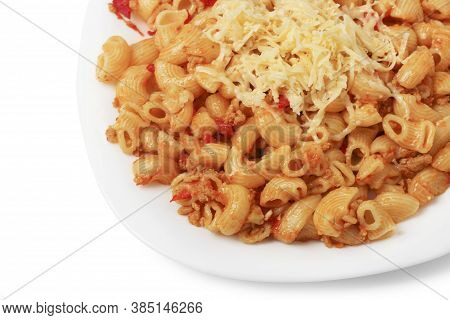 Fried Pasta With Minced Meat And Tomatoes, Sprinkled With Grated Cheese On A Plate