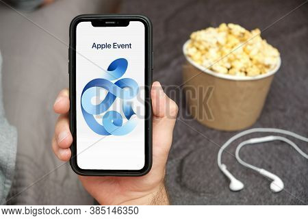 Man Is Watching Apple Event 2020 Using Iphone. Apple Logo On The Device Screen. Presentation Of New