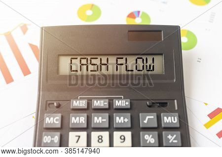 Word Cash Flow On Calculator On Financial Documents With Charts Diagrams Background, Business Cashfl