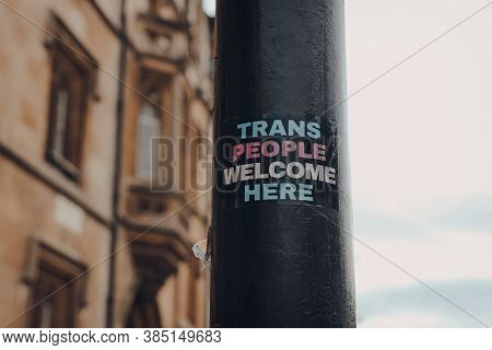 Trans People Welcome Here Sticker On A Lamppost In Oxford, Uk, Selective Focus.