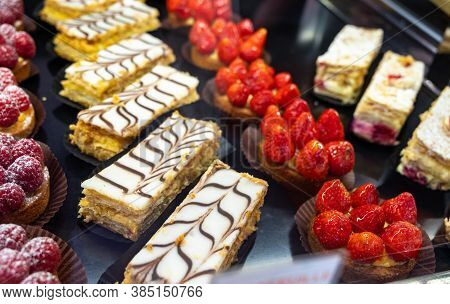 Assortment Of French Fresh Baked Sweet Pastry With Fresh Fruits And Berries In Confectionery Shop
