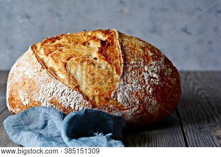 Fresh Homemade Bread On A Gray( Blue) Background. Crisp French Bread. Bread At Leaven. Unleavened Br