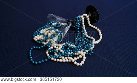 Two Mixed Strands Of Natural White Pearls And Turquoise Faux Pearls. Two Pearl Necklaces On A Blue B