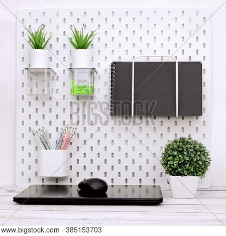 Home Desktop, Closed Laptop, Stationery Is In Order On The Desk, Office Interior,