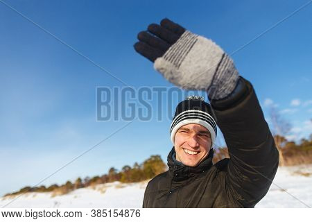 People, Christmas, Winter And Season Concept - Happy Smiling Man In Jacket And Winter Hat Enjoying S