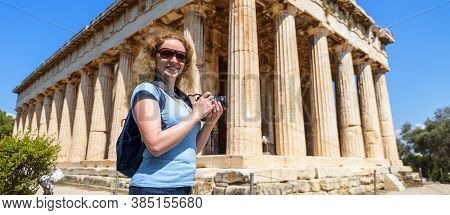 Female Tourist Visits Temple Of Hephaestus, Athens, Greece. It Is Famous Landmark Of Athens. Young P