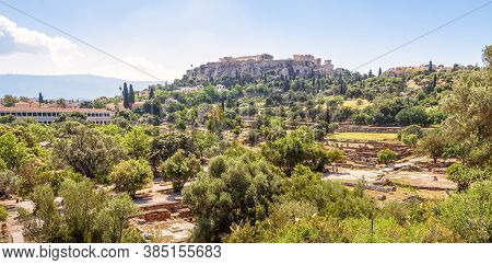 Ancient Agora In Athens, Greece. Panoramic View Of Greek Ruins And Acropolis In Distance. Urban Land