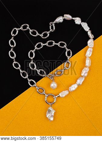 Women`s Silver Chain Necklace And Bracelet With Baroque Pearl Pendants On Yellow Black Background. C