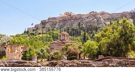 Agora In Athens, Greece. Panoramic View Of Ancient Greek Ruins And Acropolis In Distance. Urban Land