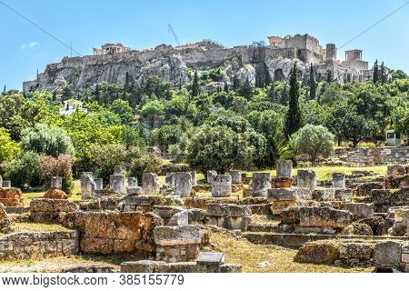 Agora In Athens, Greece. Scenic View Of Ancient Greek Ruins And Acropolis In Distance. Urban Landsca