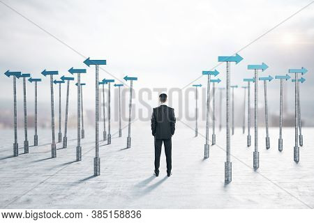 Businessman Thinks And Blue Arrows Pointers Around Him. Business And Challenge Concept.