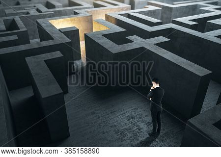 Businessman Thinking In Gray Labyrinth. Business And Challenge Concept.